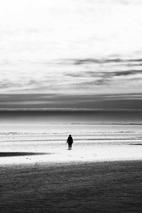 Alone on the beach by Paul Lock - Landscapes Beaches ( person, walking, black and white, dramatic, alone )
