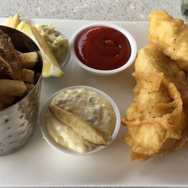 Gluten free Fish and Chips (2 pieces) with Cole Slaw and Tarter Sauce.
