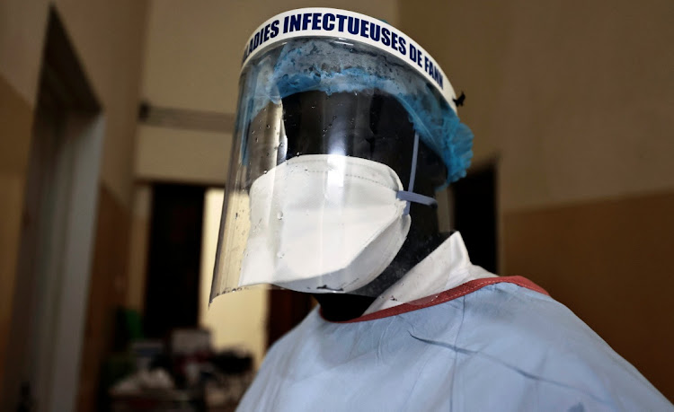 Abdoulaye Ndour, 37, a member of the medical staff is photographed while distributing the dinner to the patients suffering from the coronavirus disease (Covid-19) at the infectious diseases department of the University Hospital Fann, in Dakar, Senegal on January 7, 2021.