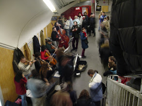 Photo: On the way back, we find this large classical string orchestra playing in the Metro.