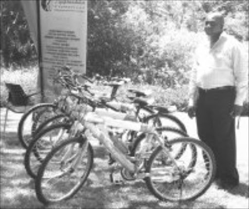 GOOD SAMARITAN: Bruce Kgapane with bicycles he gave to poor pupils in Nelspruit, Mpumalanga. Pic. Andrew Hlongwane. © Sowetan.