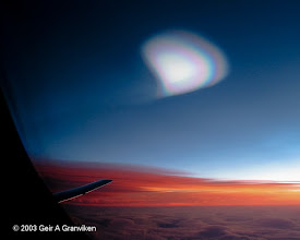 Photo: Nacreous clouds, or mother-of-pearl clouds, seen from an airliner over Southern Norway
