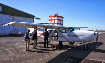 Photo: Diane, Mary Kay, and Tom boarding our 4-passenger plane at the Reykjavík domestic airport.