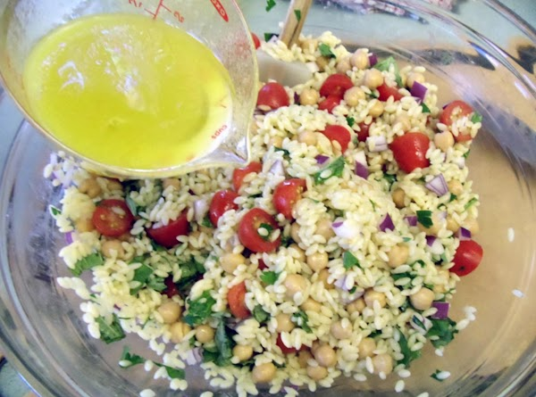 Toss the orzo with the beans, tomatoes, red onion, basil, parsley and enough vinaigrette...