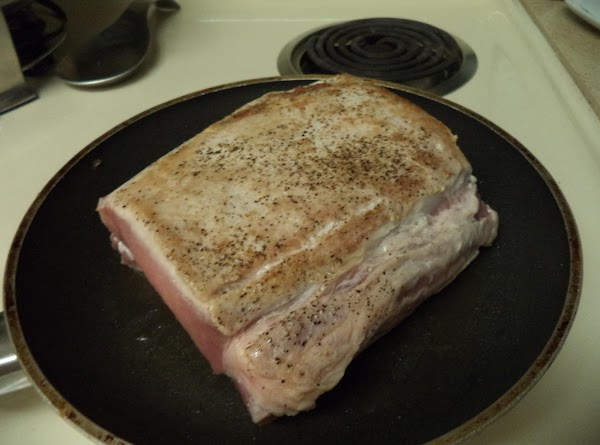 In a frying pan on med-high heat, brown the pork roast and give it...