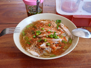 Photo: Ko Jum - yellow noodle chicken soup after my modification with dried chilli, chilli vinegar and nuts, almost unedible :-) 40B in Baan Ko Jum