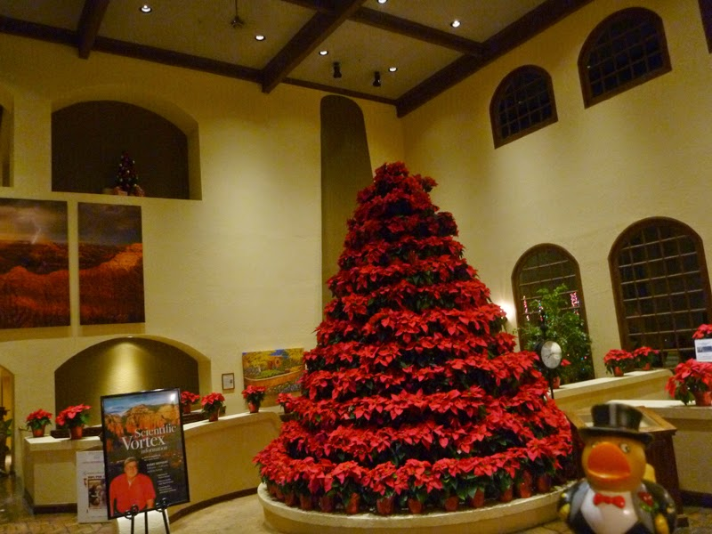 Photo: The lobby has a X-mas tree made of of poinsettias.