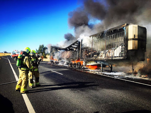 Firefighters battle the blaze on the Newell Highway on Saturday morning.