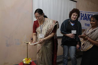 Photo: The opening ceremony starts, with the women lighting the diya
