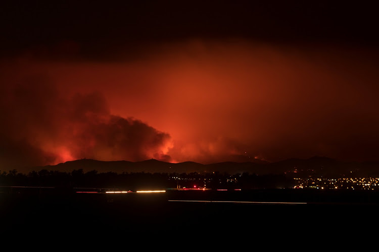 A wildfire burns on the hills of Ventura County as night falls and the winds calm near Ventura, California, U.S., December 5, 2017. REUTERS/Mike Blake