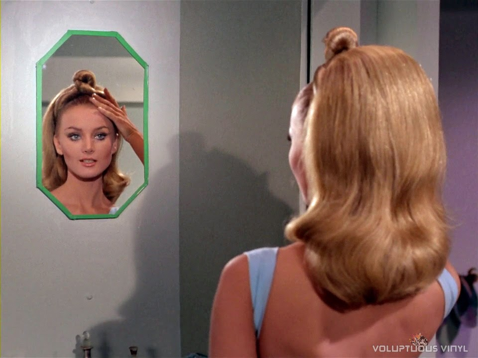 Kelinda (Barbara Bouchet) styling her hair in a mirror on Star Trek.