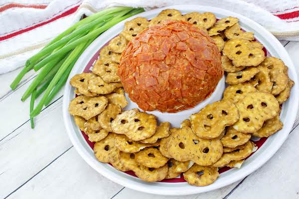 Pepperoni Cheese Ball Served With Pretzel Crisps.