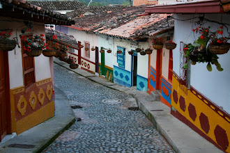 Photo: The hanging flower pots are a common decoration throughout Colombia.