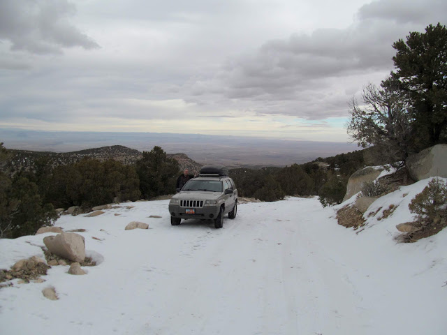 Jeep parked along the snowy road