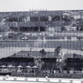 Reflections on the building  by Hush Naidoo - Black & White Buildings & Architecture ( cars, motor, reflection, trees, building )