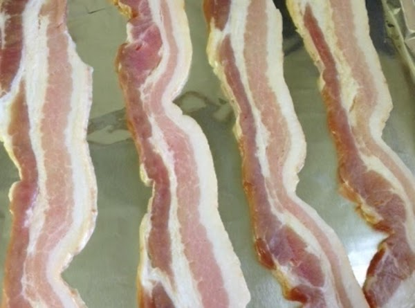 Cover a baking sheet (with sides) with foil or parchment paper.  Lay out your bacon...