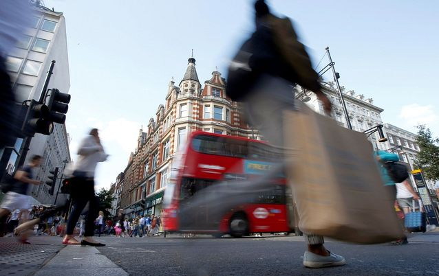 Shoppers cross the road in Oxford Street, London, Britain. Picture: REUTERS