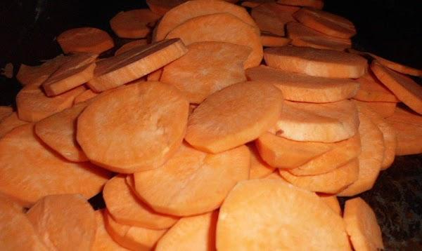 Peel and slice sweet potatoes into rounds.