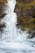 Photo: Frozen Falls  Yesterday I spent a couple hours in the Columbia River Gorge taking in the beauty of the frozen falls. There wasn't any snow on the ground, just ice and frost from when the wind catches the falls and blows it around. The temperatures have been well below freezing for about a week and it has created a splendid winter scene that many were out enjoying.  This image is of Horsetail Falls. I just loved the contrast between the ice and the moss covered cliff side. I was very thankful the wind wasn't blowing as it was hard enough with out it to keep the frost off my lens.  #crg  #waterfall