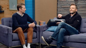 Joel McHale Wears a Navy Zip-up and High Tops