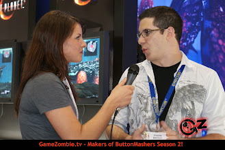 Photo: Chelsey talking with Shawn Baxter from Capcom about Lost Planet 2.