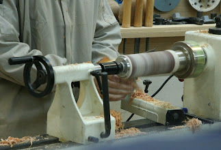 Photo: The lathe is turned into a drum sander to sand the point by hand into a pleasing shape.