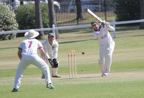 Tatts' Craig Gleeson, right, plays a cover drive on Saturday. Civeo fielders Tom Denyer (number seven) and Lachlan Cameron stay on their toes ready for a catch.