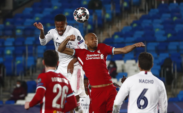 Liverpool's Fabinho in action with Real Madrid's Eder Militao