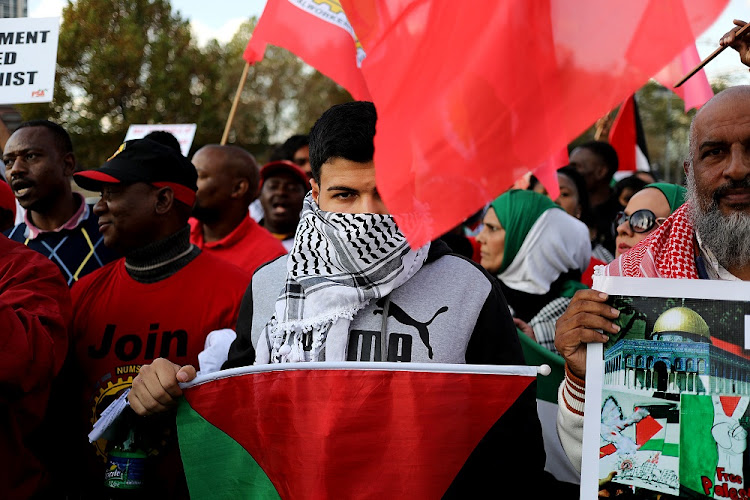 South Africans marched in solidarity with Gaza following violence on Israel's border. About 60 Gazans were killed on Monday, with most of the deaths being at the hands of Israeli Snipers according to Gaza's health ministry. The ministry said that the toll included a baby and eight children under the age of 16.