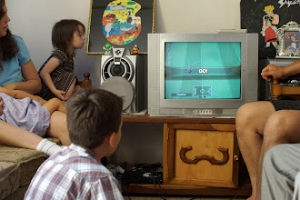 Photo: At my cousin Ivonne's house, Justin gets to play some PS3.