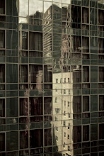 Photo: Manhattan muted  I brought the camera, but I had virtually no time to shoot anything outside of the taxicabs and my hotel room. I like the muted colors of the buildings reflected in the 1970s style glass tower, my trip spent in the sterile confines of the Le Parker Meridien in middtown.  For #365project curated by +Susan Porterand +Simon Kitcher #newyorkcity