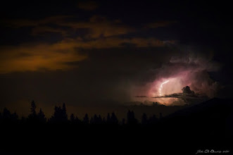 """Photo: """"Skylight"""" I am a sucker for storm photography, I absolutely love photographing it and seeing a large storm at night from the mountains here in Colorado isn't exactly a very common sight to witness. So goes this storm. A stunning supercell which was moving out of the Colorado Rockies and onto the plains this past summer. It was happening so quick that I honestly had a hard time keeping up with all the lightning flashes. I can't wait until this coming spring and summer when I get to photograph it all over again! ---John  #PlusPhotoExtract #POTD #photography #nature #Colorado #storm"""