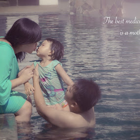 Mother's Kiss by Donny Novianus - People Family