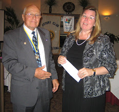 Photo: President Blaine presenting a large donation for Rotary's PolioPlus Program to District Governor Cynde Covington on June 5, 2010