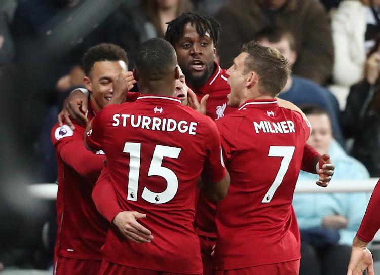 Liverpool players celebrate Divork Origi's goal in past match