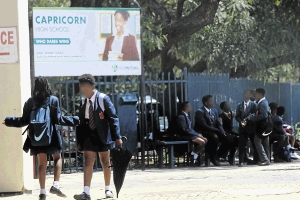 Fellow pupils mingle in school premises.