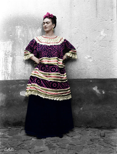 Frida Kahlo with her hands on her waist