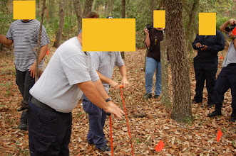 Photo: Probing around a suspect grave.  Grave fill is softer  than undisturbed soil and can be 'felt' by probing.
