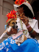 Photo: woman with dog and cigar, cuba. Tracey Eaton photo.
