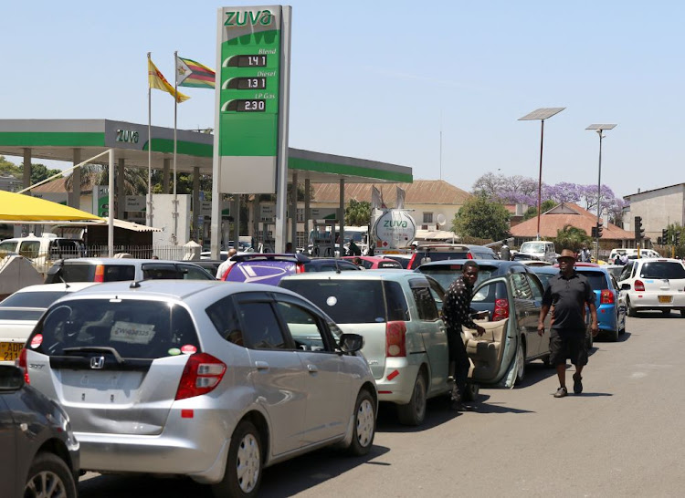Motorists queue to buy petrol in Harare, Zimbabwe, on October 8 2018.