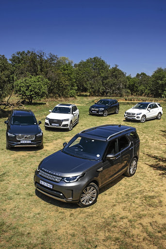 Clockwise from left: Volvo XC90, Audi Q7, BMW X5, Mercedes-Benz GLE-Class, Land Rover Discovery