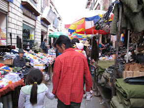 Photo: Narrower alley with stalls.