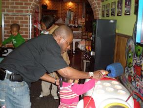 Photo: Rashid & Kaleya playing whack the mole.