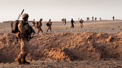 Photo: TREK NAWA, Helmand province, Islamic Republic of Afghanistan — Marines and corpsmen from India Company, 3rd Battalion, 3rd Marine Regiment, along with Afghan National Army soldiers from the 1st Kandak, 1st Brigade, 215th Corps, patrol through Trek Nawa, Afghanistan, during Operation Black Tip, Oct. 14, 2010. Black Tip was a one-day clearing operation to disrupt enemy activity, during which the Marines and Afghan soldiers detained four men suspected of combatant activity and removed a weapons cache from the area. (Official Marine Corps photo by Sgt. Mark Fayloga)