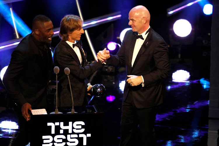 FIFA President Gianni Infantino presents Luka Modric with the Best Men's Player award.