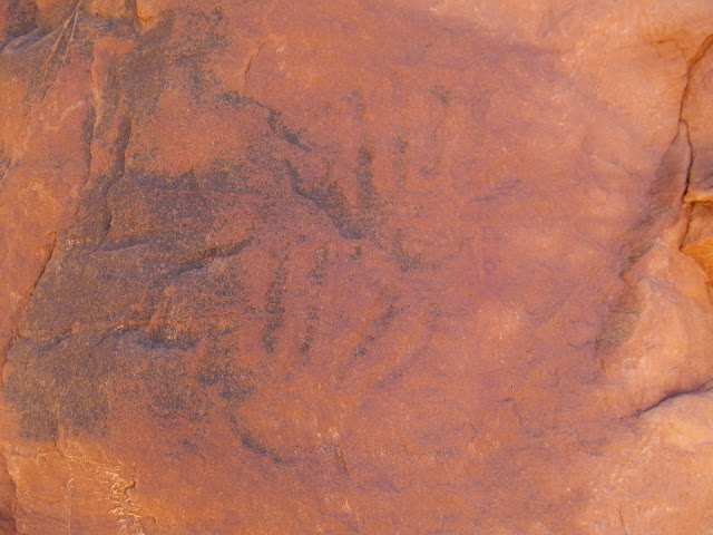Faint handprint petroglyphs