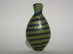 Photo: Nailsea perfume or snuff bottle with mica inclusions.