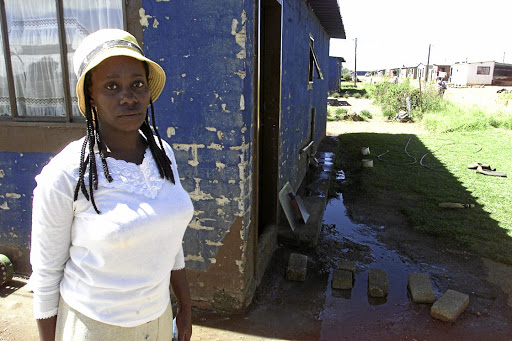 Collapse: Nono Ndlovu shows how sewage has flowed into residents' homes such as those in Evaton West, Gauteng. Picture: DUDU ZITHA