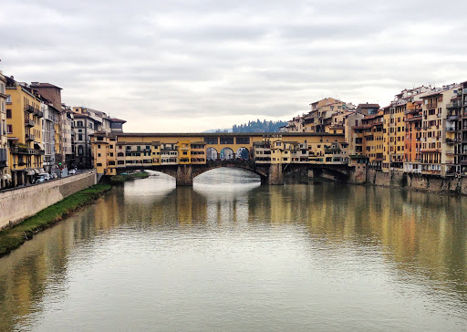 Ponte Vecchio (Italian for Old Bridge), a landmark bridge crossing the Arno River in Florence, dates to 1345.