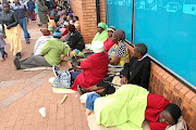 VBS Mutual Bank's customers queue outside the branch in  Thohoyandou, Limpopo,  hoping to withdraw some of their money for stokvels and burial societies.